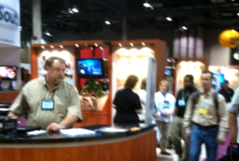 Multiple people walking around the SHOT 2010 Show Floor near the Sports South Booth