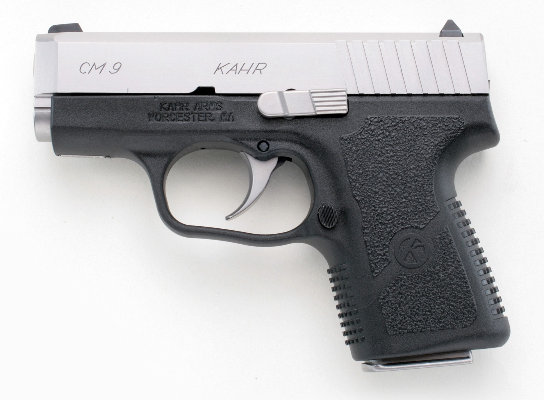 Black Kahr CM9 with silver rail, barrel pointed to the left on a white background