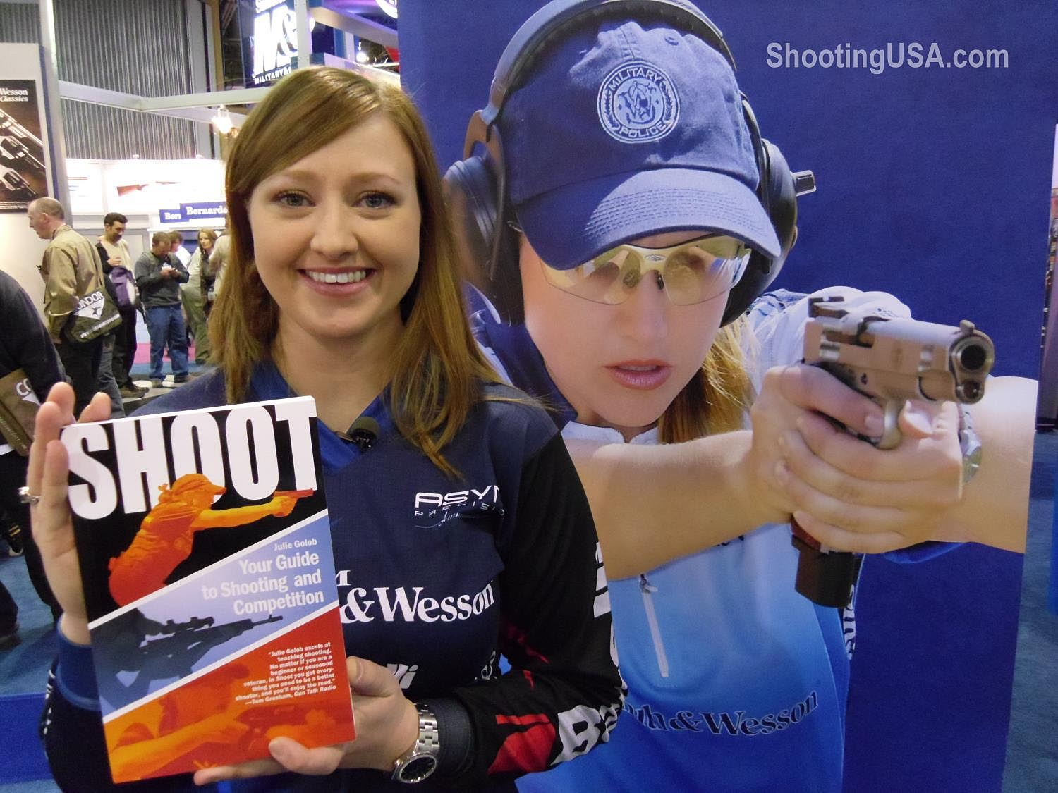Julie shows off her book at the 2012 SHOT Show. Photo courtesy of ShootingUSA.com.