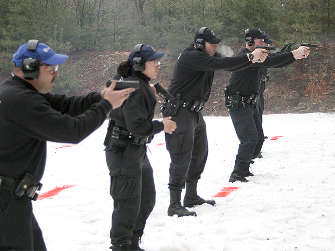 Officers Practicing Adverse Weather Shooting. Photo Courtesy of the Massachusetts State Police.
