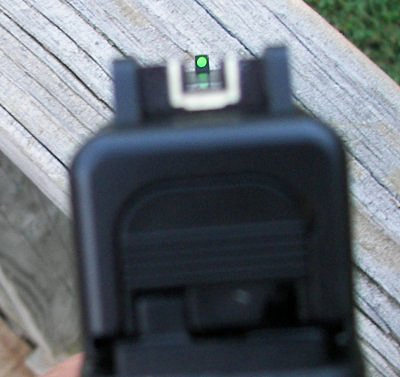 When you are focusing on the front sight, the rear sight may become blurry.