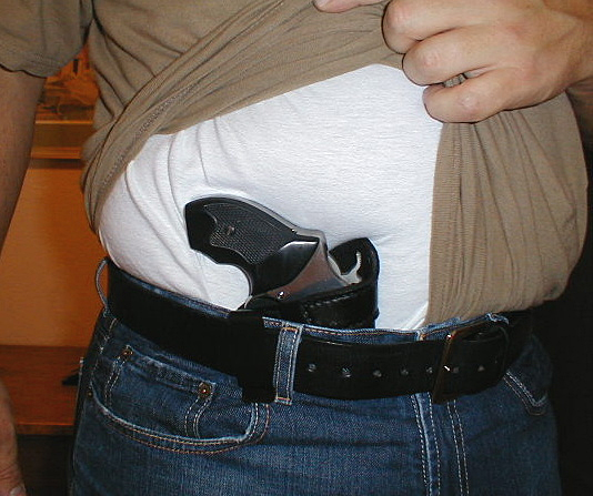 Demonstrating appendix carry in an inside of the waistband holster