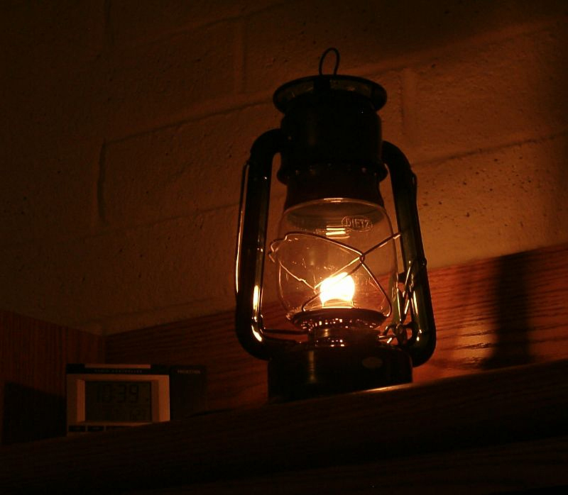 A lantern is safer than candles and will put out more light.
