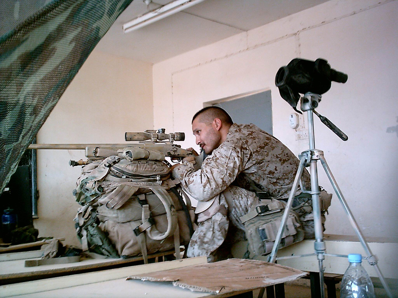 Sniper shooting from cover
