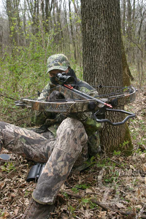 Crossbow-Hunter Wearing Mossy Oak Camo