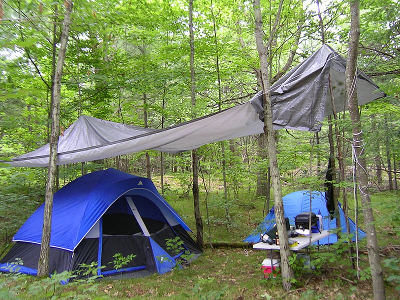 You can make a rain fly makeshift shelter and eating cover simply out of rope & Preparing Your Gear for Spring Camping