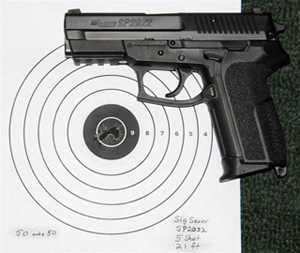 Black SIG SP2022, barrel pointed to the left with a target in the background