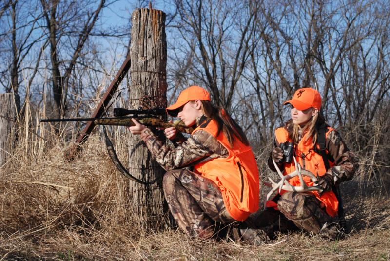 Women hunters dress in orange