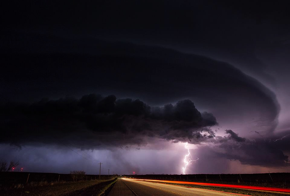 Picture shows a spring storm over an open highway.