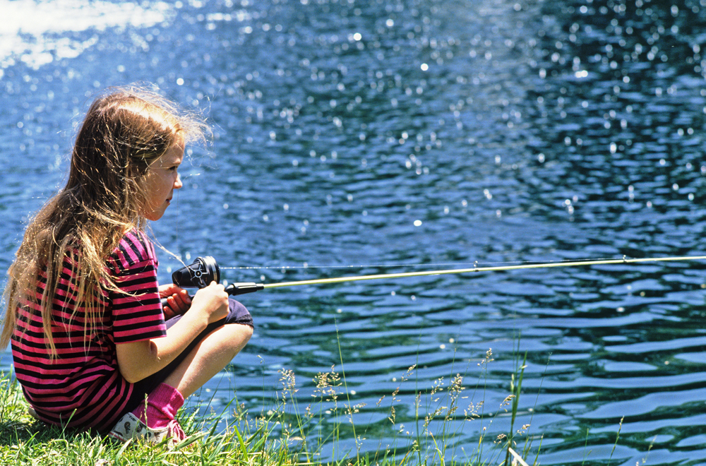 Picture shows a little girl fishing.