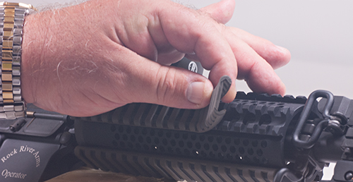 Magpul's AR-15 Ladder Rail Protector makes handling quad rails a little more comfortable.