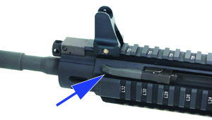 The operator can charge, clear, or forward assist the B.E.A.R. with the front hand using the ambidextrous forward-placed charging handle/forward placed assist. The operator pulls the handle to open the action. Underneath is a retention notch, which accepts the folded-in handle when it's reversed.