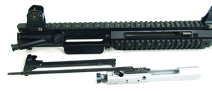 Some of the components of the Adcor Bear include the bolt in front, op rod attached to the bolt, and rear charging handle. Adcor says the design of the Elite's gas-piston system and operation rod eliminates carrier tilt.