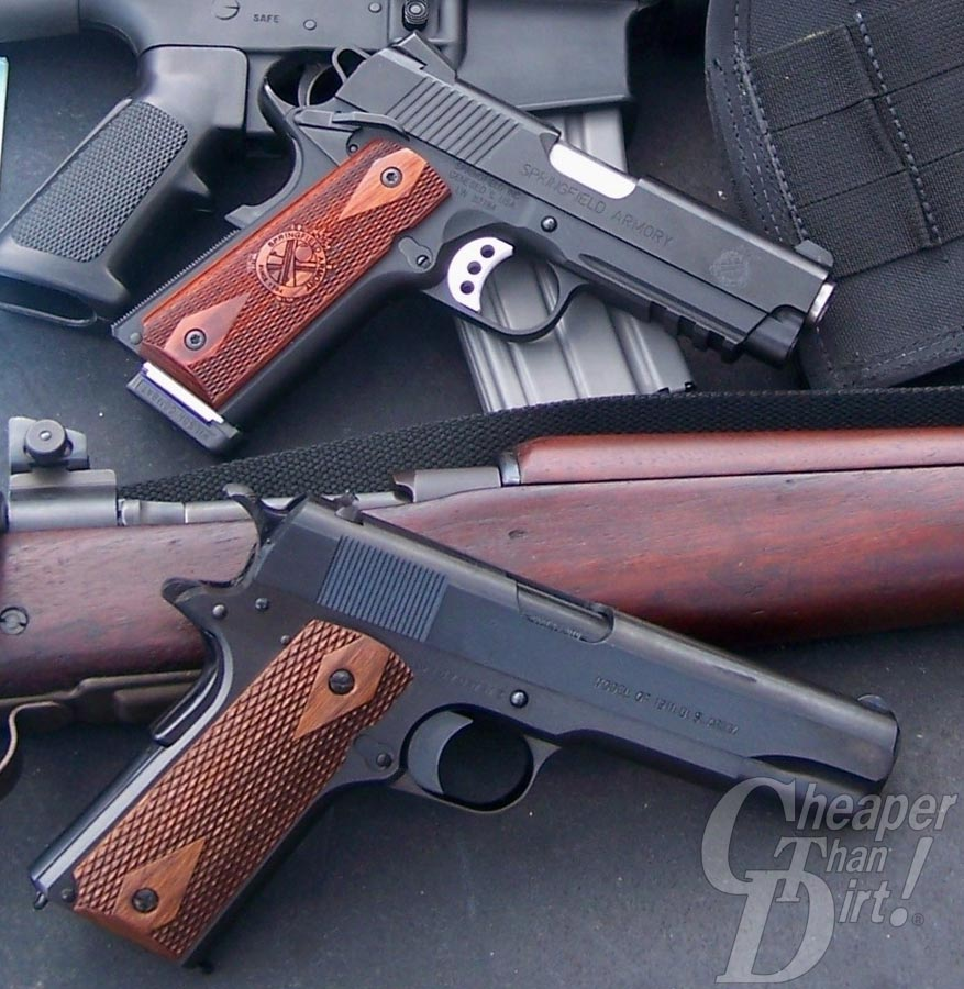 Two 1911 pistols posed over a Springfield 1903 A3 and AR-15 rifle