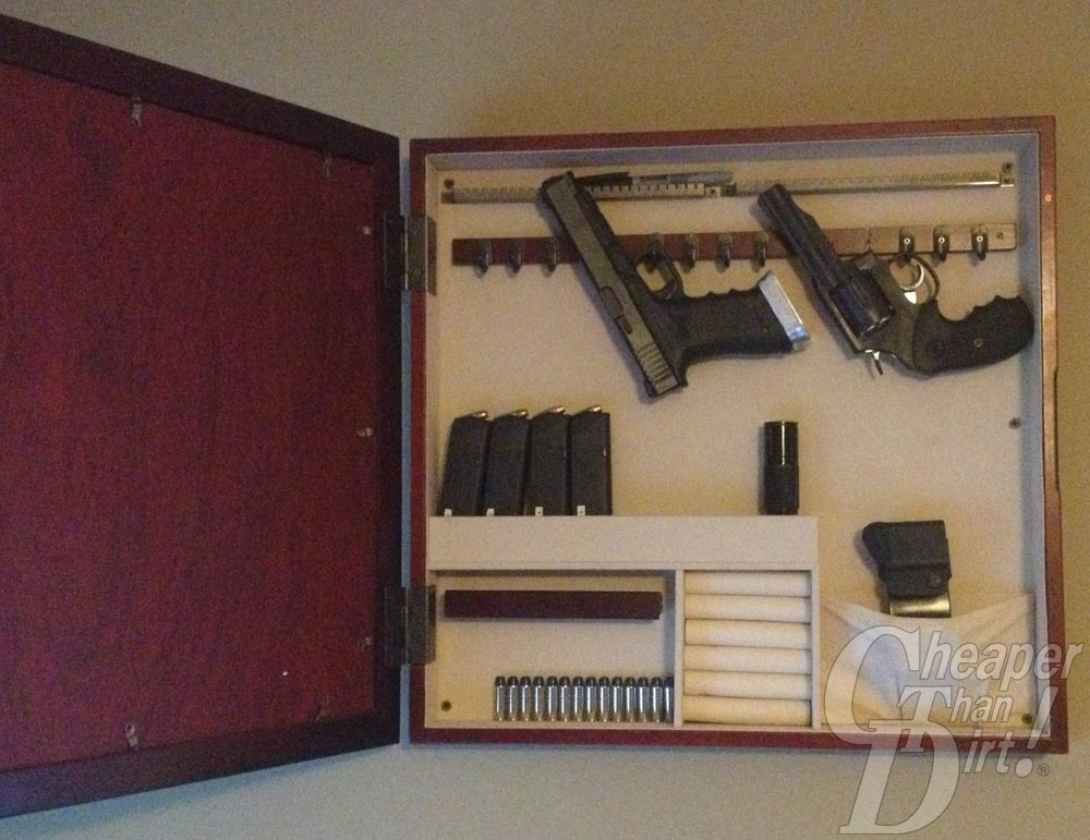 Picture shows the inside of a jewerly case repurposed as gun storage.