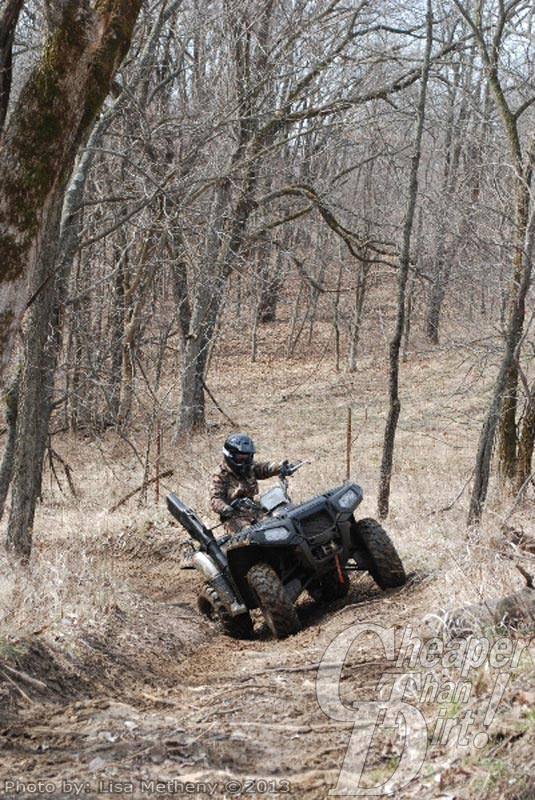 Having fun on a ATV in the woods
