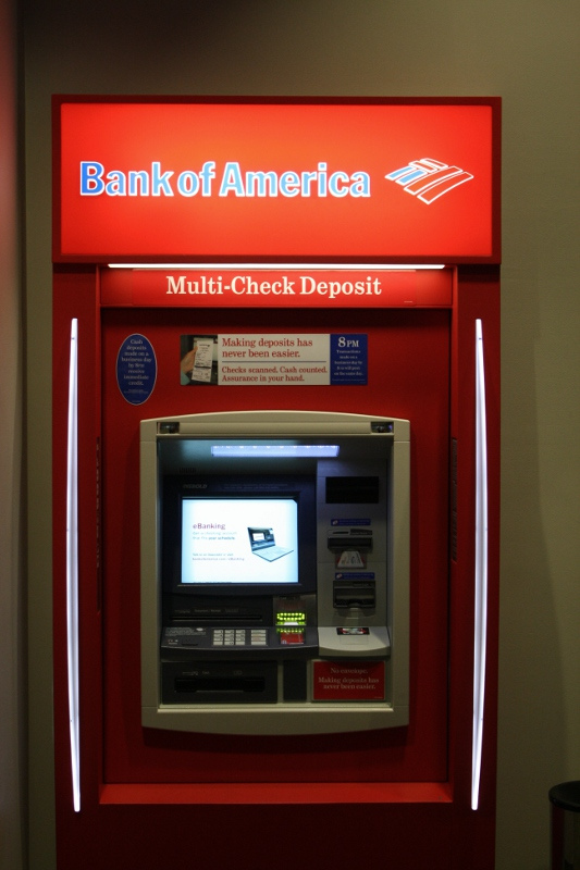 Picture shows a red Bank of America ATM.