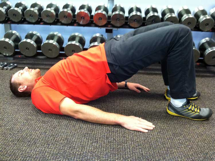 Person on floor finishing glute excerise