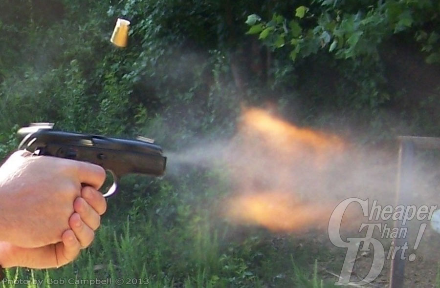 Pistol firing with expended shell still in the air