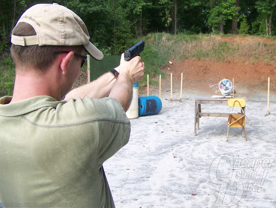 Shooter testing bullets by shooting wet newsprint