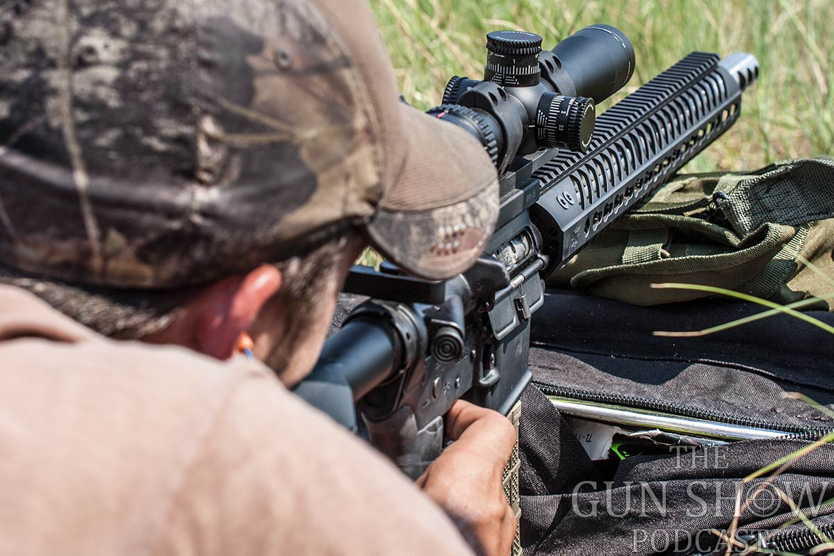 Picture shows a guy shooting an AR015 with a KeyMod rail system.