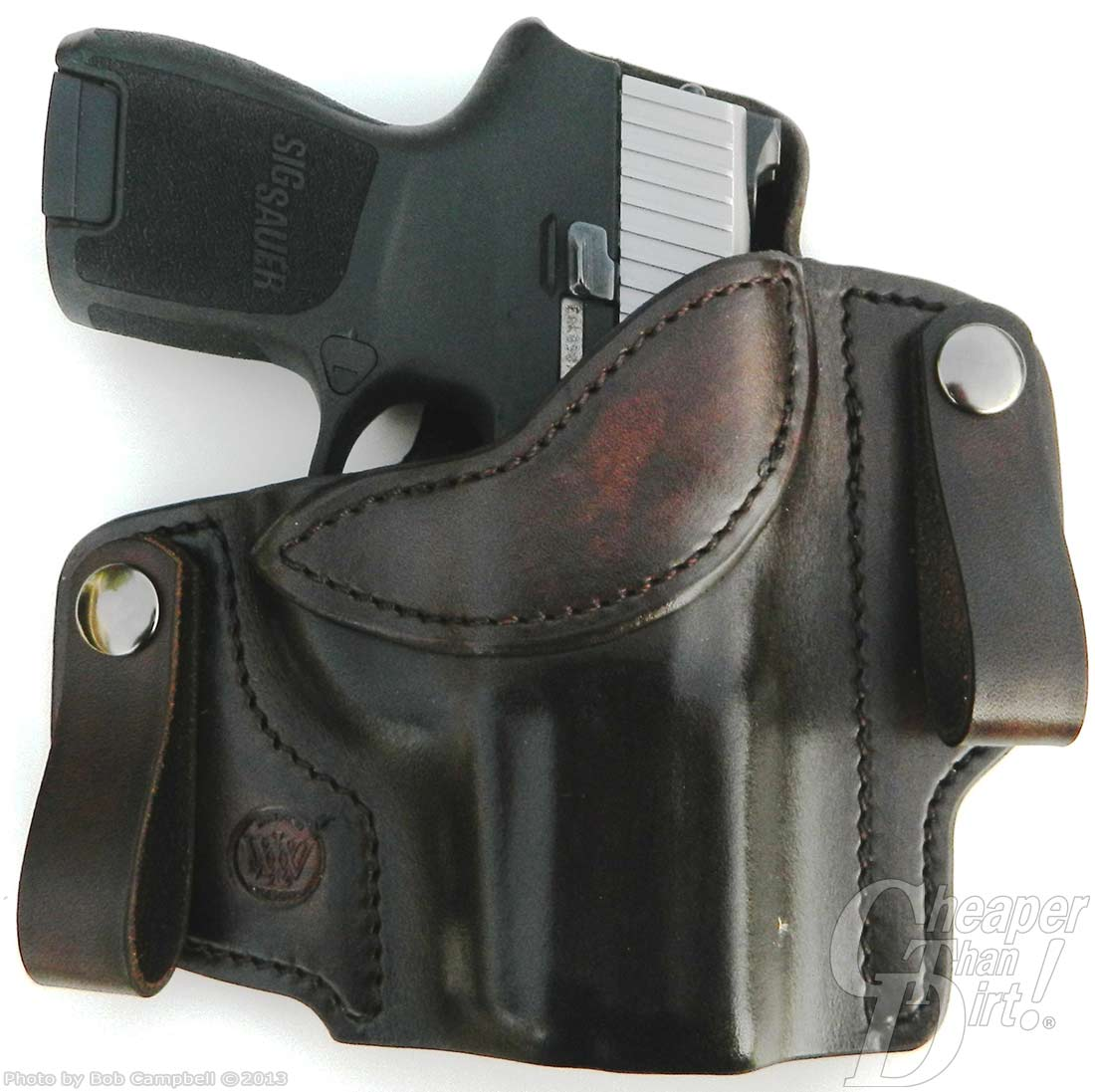 A black leather Wright Leatherworks Banshee holster with the black handle of a SIG P 250 showing