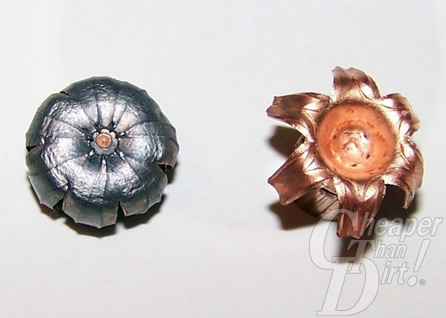 One silver-colored (on the left) and one copper-colored (on the right) Cor-Bon hollow bullet point on a light gray background.