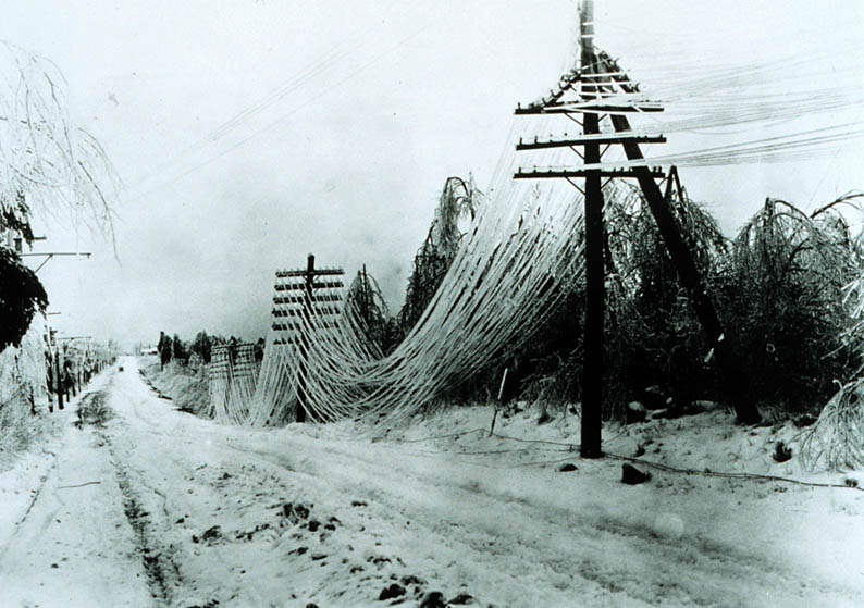 Picture shows damaged powerlines covered in ice.