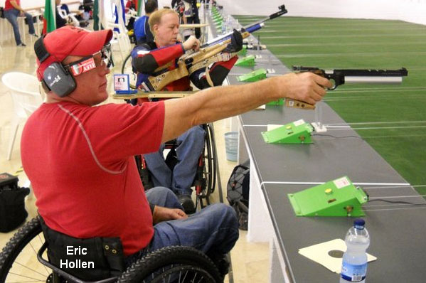 Eric Hollen seated in his wheel chair shooting a competition pistol.