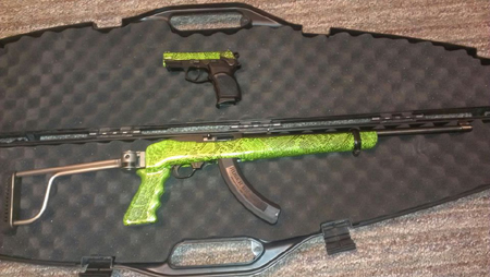 J B.'s Ruger is decked out in Zombie Green with rattlesnake hydrographics.
