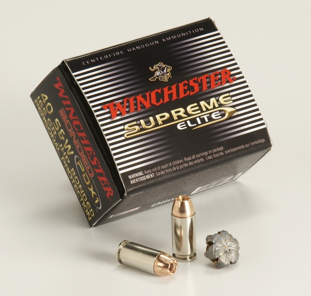 Manufacture display of Winchester Supreme rounds with a black cartridge box