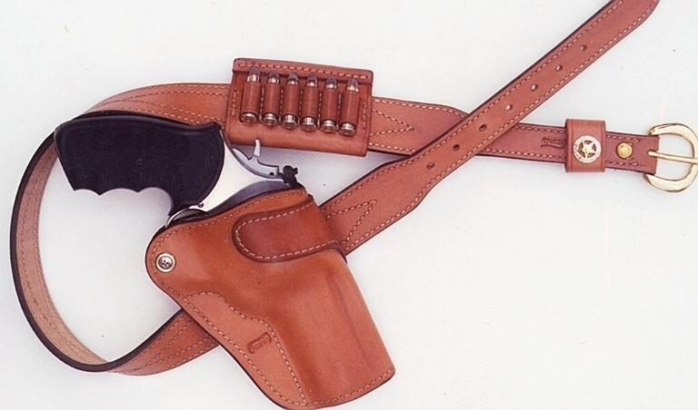 Four-inch .357 Magnum with black handle and cartridges showing in a medium tan Taurus holster