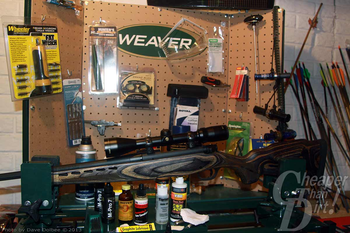 Picture shows a rifle on a rest being prepped for cleaning.