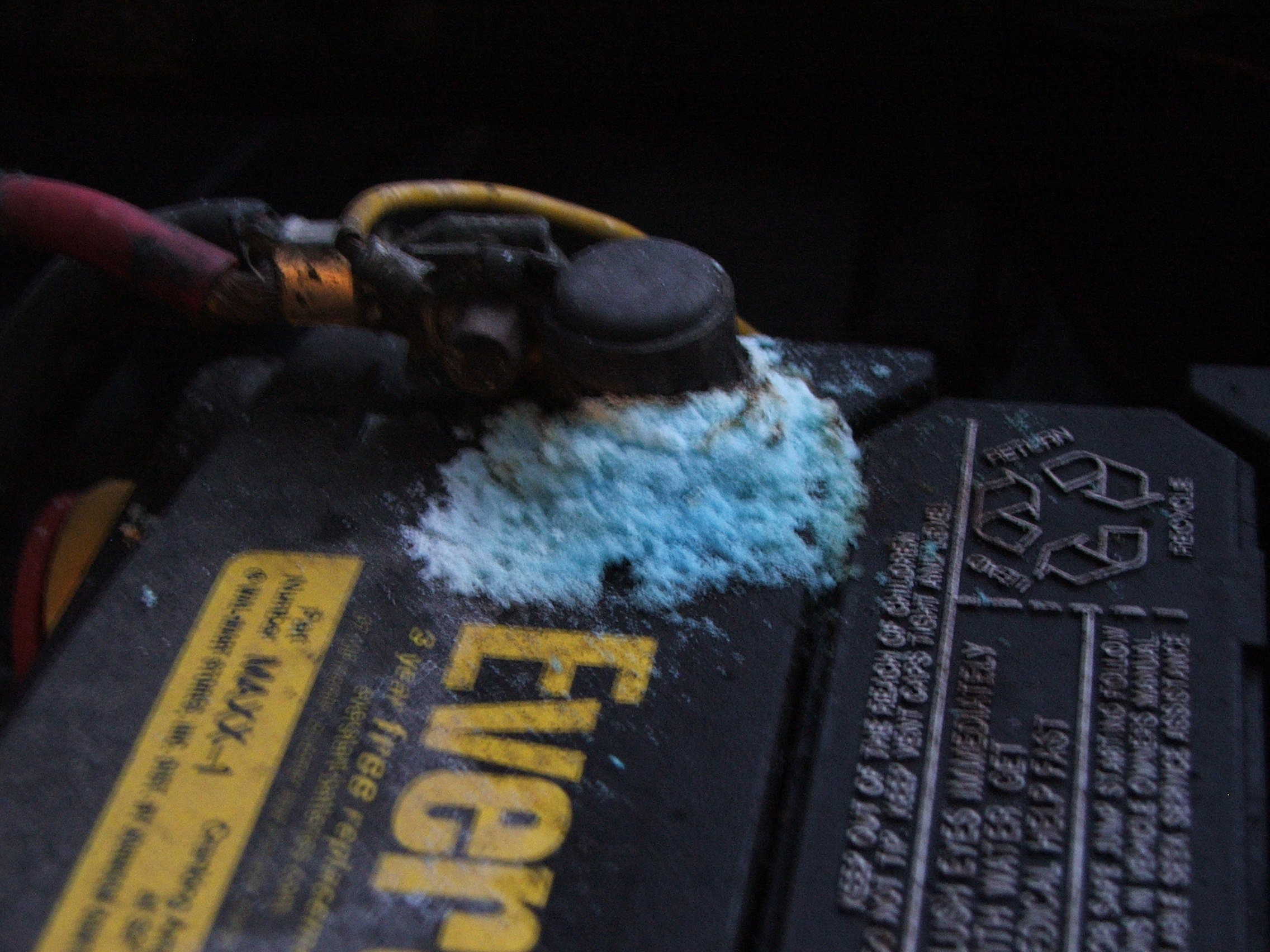 Car batter showing corrosion a terminal with severe corrosion