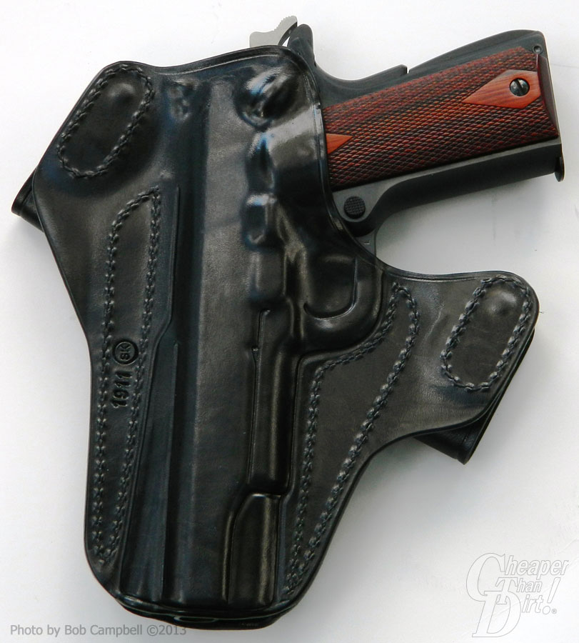 Colt Series 70 with brown grip showing in a black Milt Sparks Nexus holster