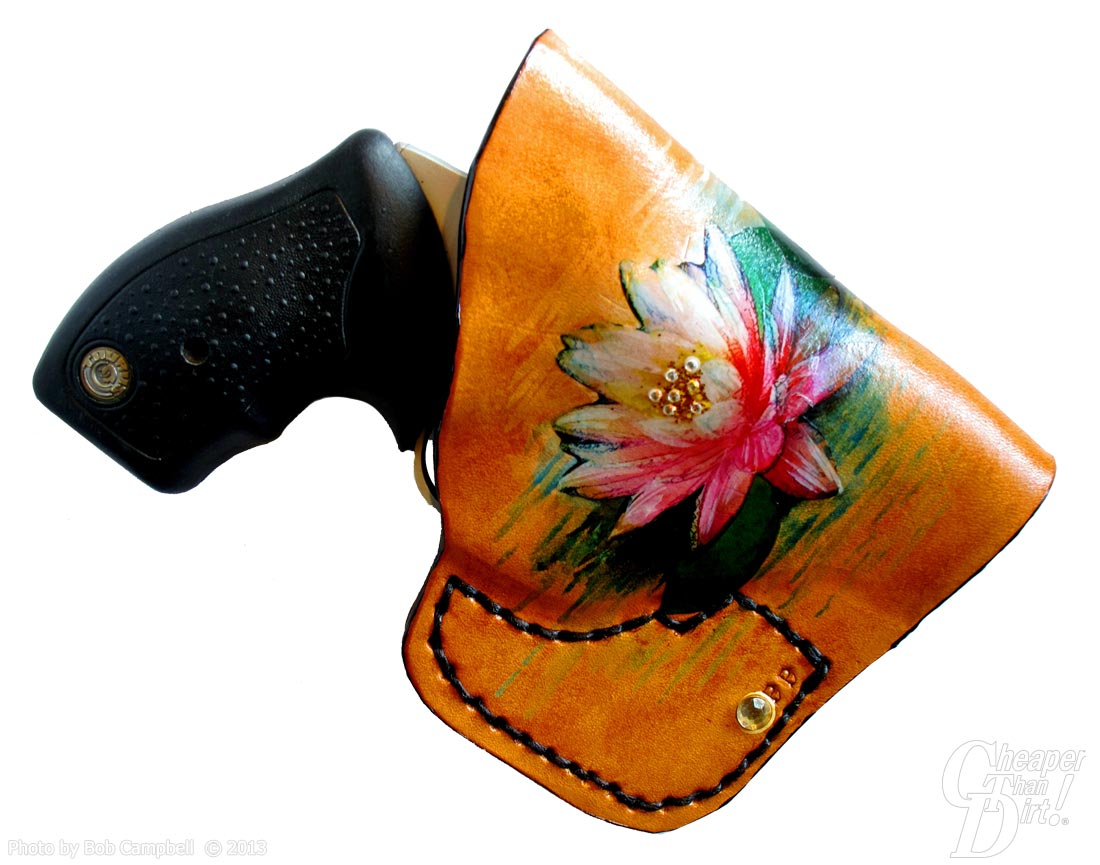 Light brown pocket holster with a pink/cream lotus blossom with black grip exposed on a white background.