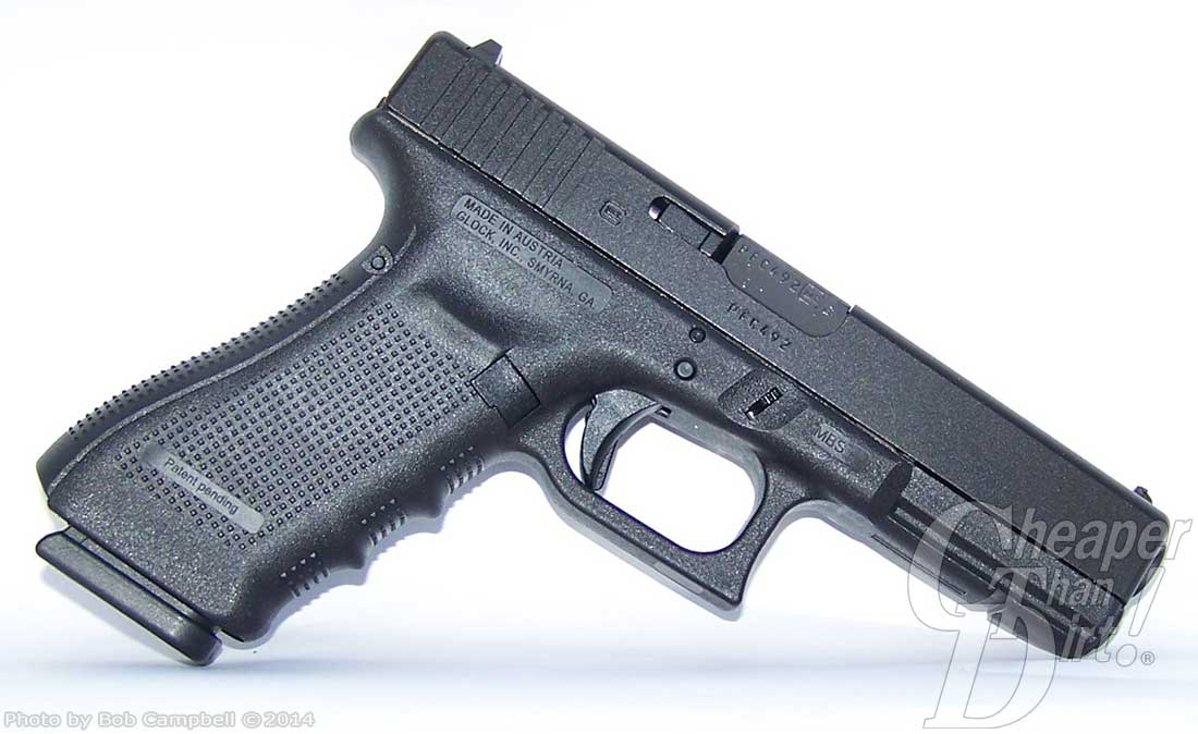 Dark silver Glock 17 Gen 4 barrel pointed down and to the right on a white background.