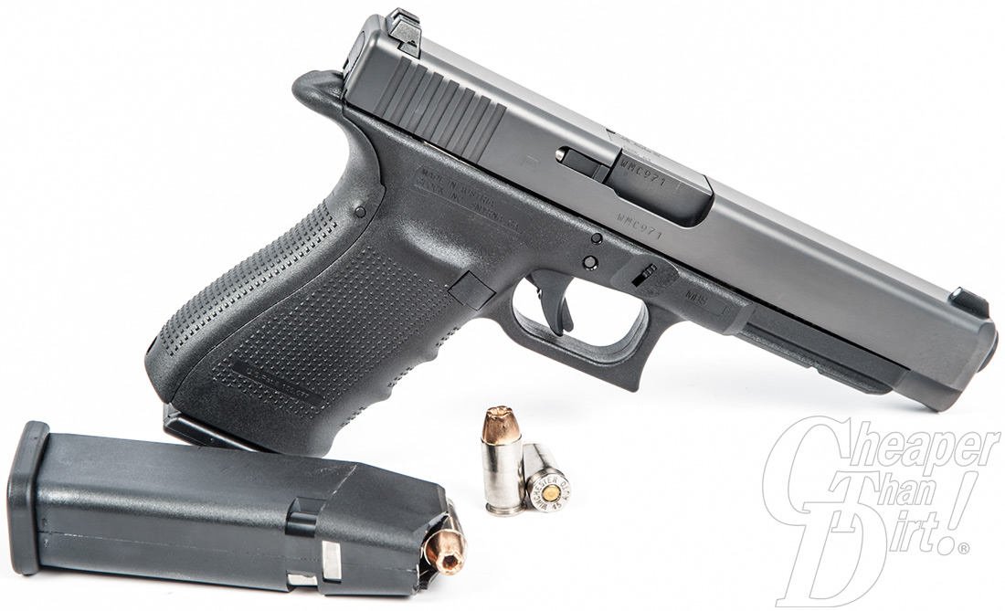 The dark silver Glock 431 , barrel pointed down and to the right with a magazine and cartridges against a white background.