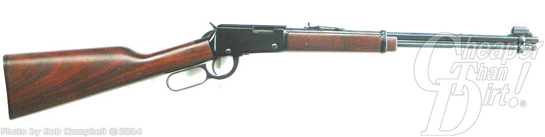Henry rifle with wood-grained stocked, barrel pointed to the right on a white background.
