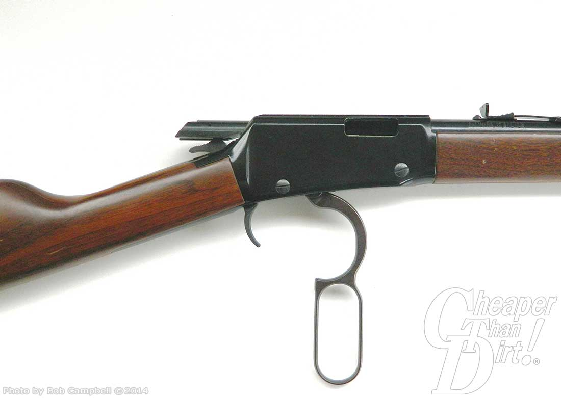 Image focused on the bolt action for the Henry rifle on a white background.