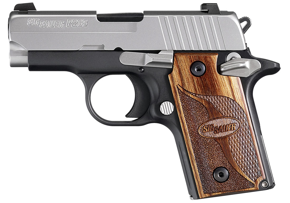Picture shows the left side of SIG P938 handgun with black frame, stainless steel slide and wood grips.