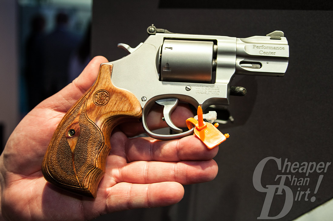 S&W Performance Center Model 686 short-barreled revolver with custom wood grips.
