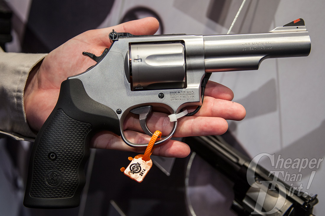 Picture shows the right side of a S&W Model 69 stainless steel revolver with black rubber grip.