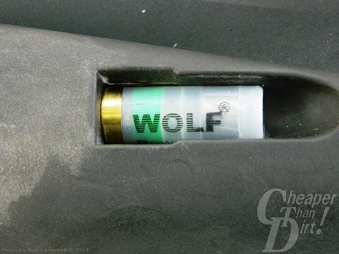 The silver Speed Feed stock of the RIA shotgun with a Wolf cartridge.