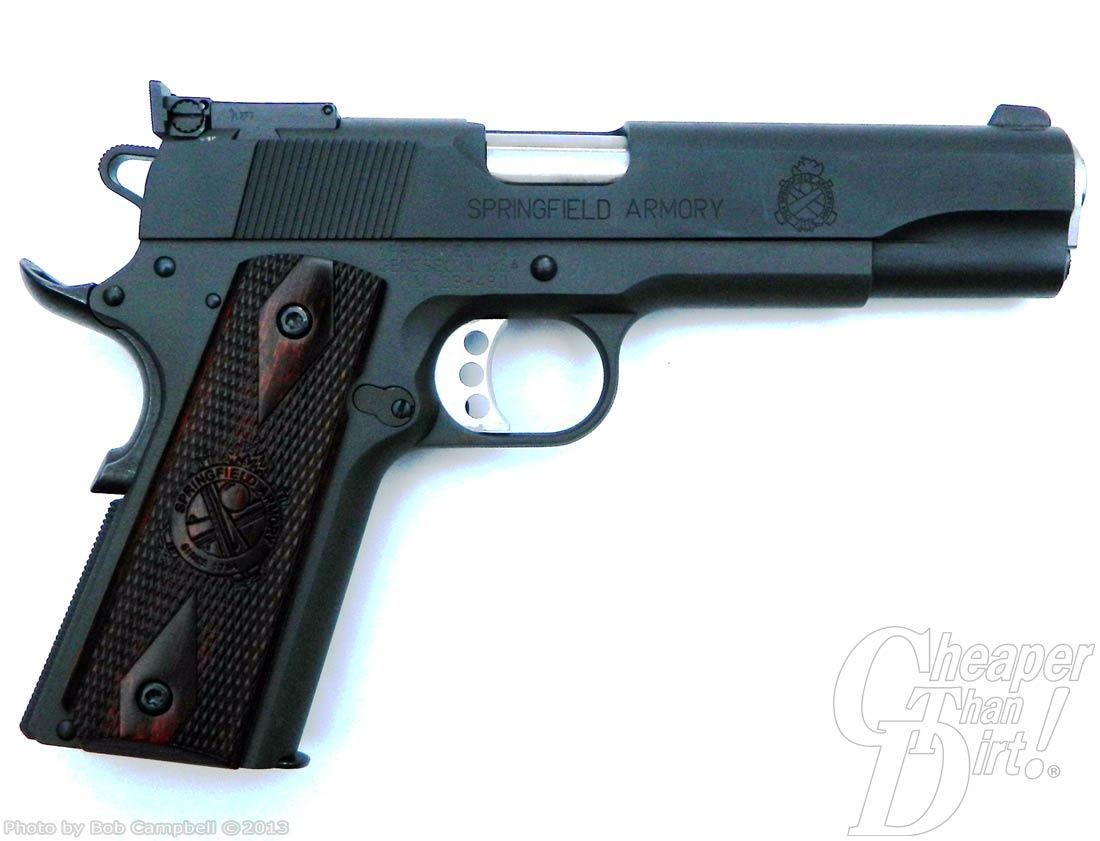 Black Springfield Range Officer with dark brown grips on a white background, facing right.
