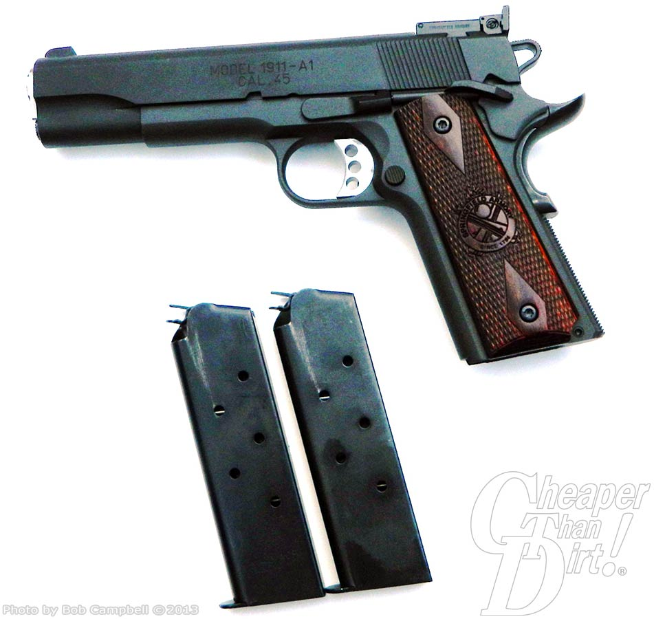 A black Range Officer with a dark brown grip at the top and two dark gray metal Springfield magazines at the bottom on a white background.
