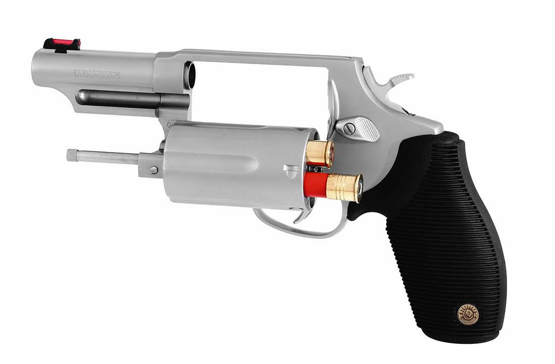 Taurus Judge with black grip and silver frame on a white background, barrel pointed to the left.