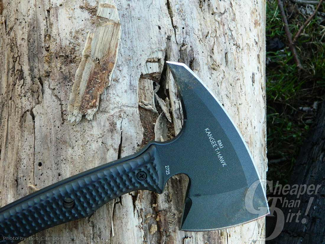 Black CRKT T-Hawk blade down on a old tree trunk.
