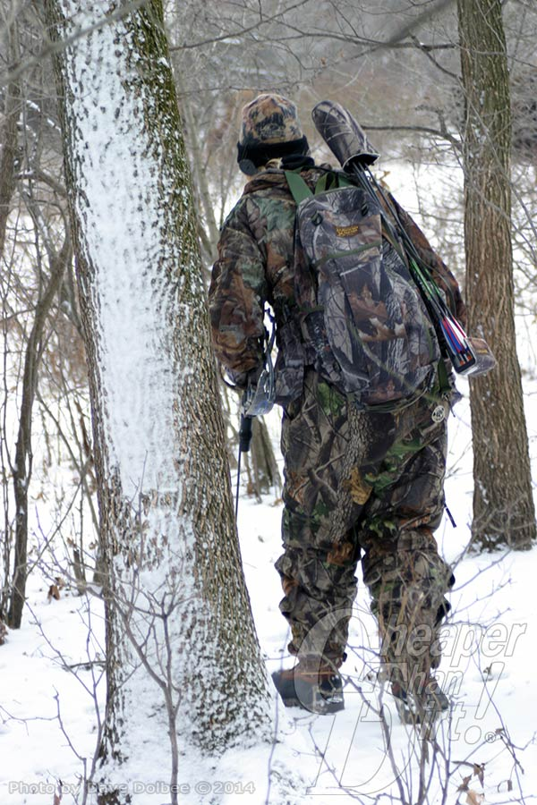 Bowhunter stalking game in snow