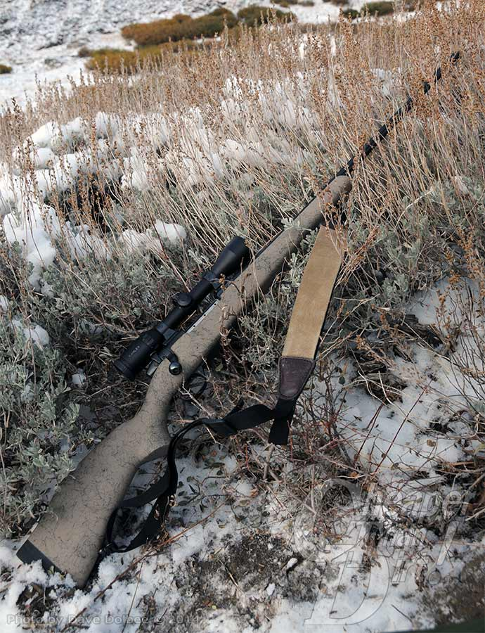Weatherby rifle laying in the snow